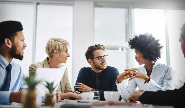 Group of people deep in discussion in a meeting