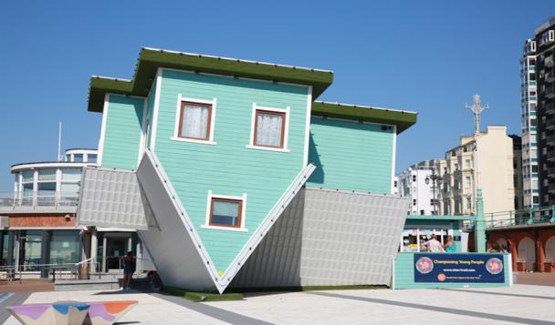 An upside down house art installation on Brighton beach, England