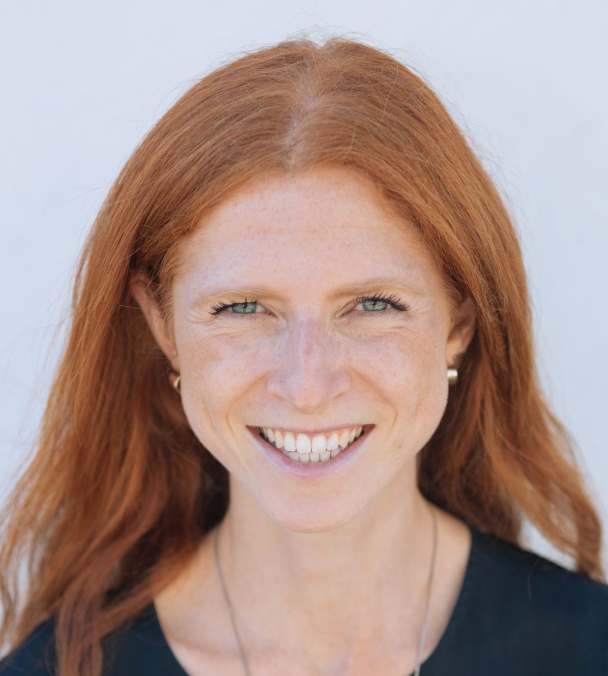 Full face profile headshot of a woman smiling at the camera