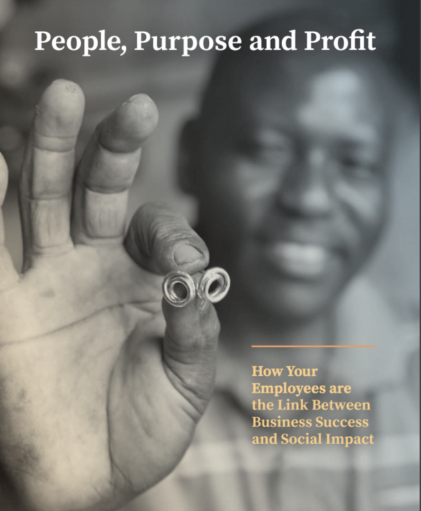 Photo of a smiling man holding up links to symbolise the link between business success and social impact